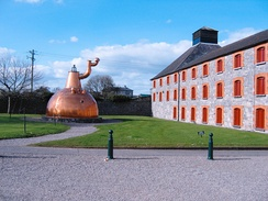 The Old Midleton Distillery, built in 1825, hosts a mammoth 31,618 gallon Pot still, so big that the still room needed to be built around it. Although no longer in use, it remains in place inside the old distillery building.[4]
