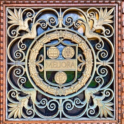 This decorative rendering of the University seal appears on Rush Rhees Library