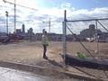 April 11, 2014: Construction worker controlling traffic and site access