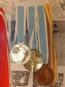 Two gold and bronze Olympic medals from XIII Olympic Winter Games, designed by Gladys Gunzer