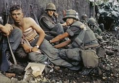 Marine gets his wounds treated during operations in Huế City, 1968