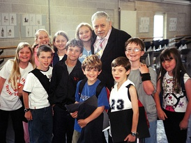 "Original London Cast ""Janes & Michaels"", Left to right (FRONT): Poppy Lee Friar, Jack Montgomery, Perry Millward, Harry Stott, Ben Watton, Jake Catterall, Nicola Bowman. Left to right (BACK): Charlotte Spencer, Faye Spittlehouse, Carrie Fletcher, with songwriter Robert B. Sherman. (Photo Date: 19 July 2004)"