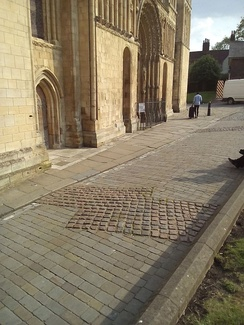 Setts showing the outline of the first building.