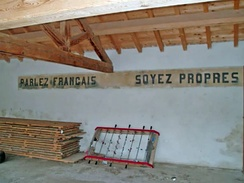 """Speak French, be clean"", school wall in Ayguatébia-Talau, 2010"