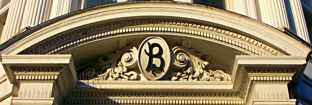 Intricate detailing on the pediment above the entrance to the Barclays Bank building in the Sutton town centre conservation area