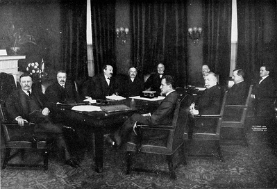 Roosevelt's cabinet on his last day in office, 1909.At far left: RooseveltLeft to right in back of table: George B. Cortelyou, Charles Joseph Bonaparte, Robert Bacon, James Wilson, Truman Handy Newberry.Left to right in front of table: Oscar S. Straus, Luke Edward Wright, George von Lengerke Meyer, James Rudolph Garfield