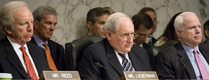 In June 2009, Armed Services Committee senators Joe Lieberman, Carl Levin (chair), and John McCain, listen to Secretary of the Navy Ray Mabus deliver his opening remarks for the fiscal year 2010 budget request in June 2009.