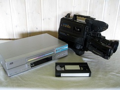 VHS recorder, camcorder and cassette.