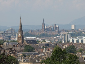 Panorama over Glasgow's South Side and West End from Queen's Park, looking north west. Left of centre can be seen the Clyde Arc bridge at Finnieston, while beyond is the tower of the University of Glasgow, with the Campsie Fells in the distance on the right.