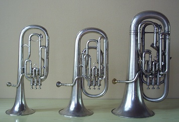 A tenor horn (alto horn) in E♭, baritone horn in B♭, and euphonium in B♭.