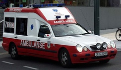 "Norwegian ambulances changed their markings in 2005. This is the old appearance, with the Norwegian ambulanse, ""Ambulance."""