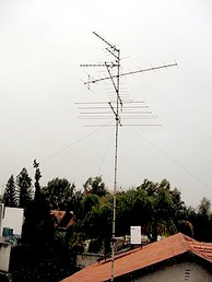 Rooftop television antennas. Yagi-Uda antennas like these six are widely used at VHF and UHF frequencies.