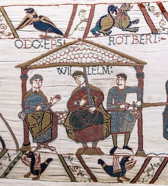 The Bayeux Tapestry (detail) showing William the Conqueror (centre), his half-brothers Robert, Count of Mortain (right) and Odo, Bishop of Bayeux in the Duchy of Normandy (left)