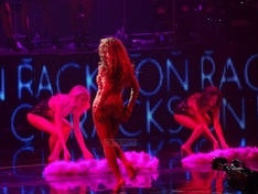 "Beyoncé performing ""Party"" which featured a Las Vegas showgirl theme"