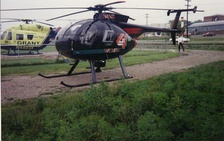 "The old WCMH TV ""Chopper 4"" landed at Wellston Heliport Base while covering a breaking news story as, Grant Lifeflight II's BK 117 N4493X sits on the pad. It was later replaced by the helicopter pictured below in the early 2000 (picture taken by Earl Wilbur and was used with the photographer's permission)."