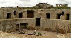 Gun emplacement in Fort Campbell, built in the 1930s. Due to the threat of aerial warfare, the buildings were placed at a distance from each other, making it difficult to find from the air.