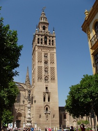 La Giralda, originally built by the Almohads as a minaret to the Great Mosque of Seville, is now the bell tower of the cathedral.