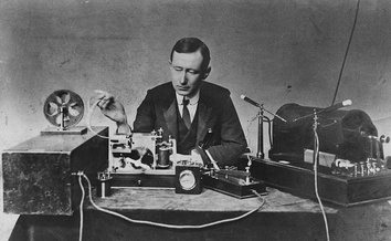 Guglielmo Marconi, who built the first radio receivers,  with his early spark transmitter (right) and coherer receiver (left) from the 1890s. The receiver records the Morse code on paper tape