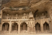 Jainism-related cave monuments and statues carved into the rock face inside Siddhachal Caves, Gwalior Fort.