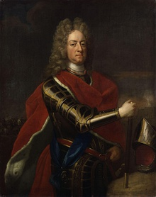Painted portrait of a clean-shaven man with long hair or a wig in full armour with a red sleeveless cloak over it holding a staff