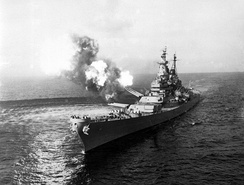 To disrupt North Korean communications, USS Missouri fires a salvo from its 16-inch guns at shore targets near Chongjin, North Korea, 21 October 1950