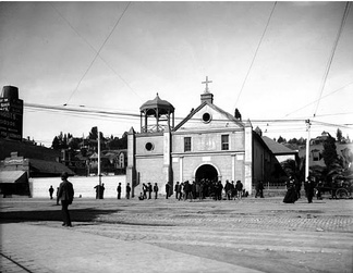 "People gather in the original Plaza in front of the ""Old Plaza Church"", circa 1890-1900."