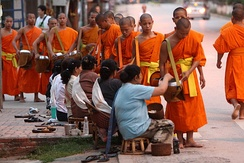 Buddhist monks collecting alms in Luang Prabang, north Laos.