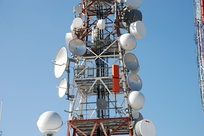 Parabolic antennas of microwave relay links on tower in Australia.