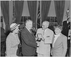President Truman presents the Congressional Gold Medal to Vice President Barkley honoring his years of legislative service.