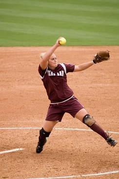 "Fastpitch pitcher Megan Gibson pitching the ball in the ""windmill"" motion"