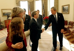 President George W. Bush congratulates Senator Mike DeWine on the passing of the Pediatric Equity Research Act of 2003.