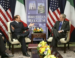 Berlusconi smiles with U.S. President George W. Bush at the NATO headquarters in Brussels.