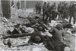 Polish Jews pulled from a bunker by German troops; Warsaw Ghetto Uprising, 1943