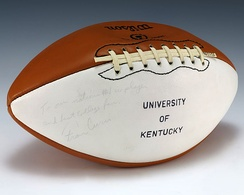 A football signed by Fran Curci and gifted to President Gerald Ford.