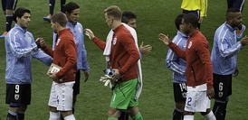 Gerrard (second from left) shaking hands with Uruguay's Luis Suárez at the 2014 FIFA World Cup, 19 June 2014.