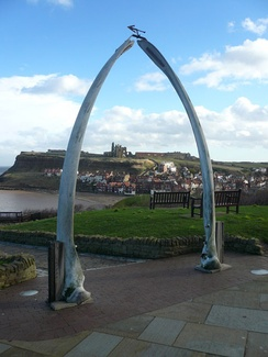 The whalebone arch on the West Cliff at Whitby commemorates the port's historic link with the whaling industry