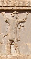 "The ""Ionians with shield-hats"" (Old Persian cuneiform: 𐎹𐎢𐎴𐎠𐏐𐎫𐎣𐎲𐎼𐎠, Yaunā takabarā)[20] depicted on the tomb of Xerxes I at Naqsh-e Rustam, were probably Macedonian soldiers in the service of the Achaemenid army, wearing the petasos or kausia, c.480 BC.[21]"