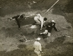 Likely Giants pitcher Art Nehf sliding in safely at home during game one of the 1924 World Series.