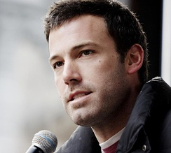 Ben Affleck speaks into a microphone