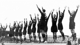 The All Blacks at the climax of their haka before a 1932 test against Australia