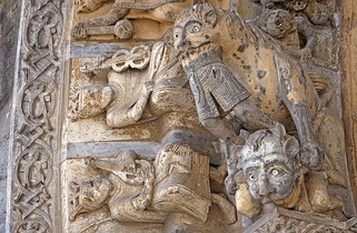 Details of the portal of Oloron Cathedral show a demon, a lion swallowing a man and kings with musical instruments.