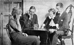 A family listening to a crystal radio in the 1920s.