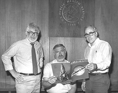 Three former directors of the Global Smallpox Eradication Program read the news that smallpox had been globally eradicated, 1980