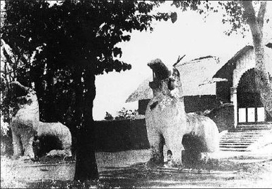 Kangla Uttra Sang at the Kangla Fort, the former residence of the Manipur royal family. The two Kangla-Sa Pakhangba dragons standing at the gate were destroyed by the British.[465]