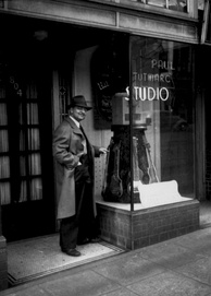 Musical instrument inventor Paul Tutmarc outside his music store in Seattle, Washington