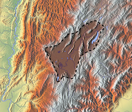 The flat Bogotá savanna, the southern territory of the Muisca Confederation, not only provided fertile agricultural lands, but also many different clays for the production of ceramics, rock shelters where petroglyphs and petrographs were made and a central strategic access to the regions around it. This made trade with various neighbouring indigenous groups possible by which the Muisca obtained feathers, cotton, pigments and the vast amounts of gold and copper used for their fine tunjos, jewelry, and other golden and tumbaga artefacts