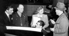 Sinatra (left) on the Armed Forces Radio in 1944