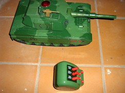 A toy tank with a remote control. Such toys are generally thought of as boys' toys.
