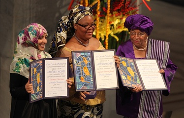 From left to right: Tawakkul Karman, Leymah Gbowee, and Ellen Johnson Sirleaf display their awards during the presentation of the Nobel Peace Prize, 10 December 2011 (photo: Harry Wad).