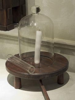 A model of Joseph Priestley's bell jar containing a candle